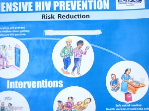 This picture was taken in a Catholic run health centre in Kenya. It is a HIV/AIDs prevention poster in which a sticker has been put over the phrase 'Use a Condom'.